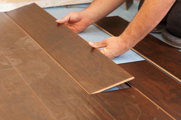 laminate versus hardwood flooring  abbey carpet  floor